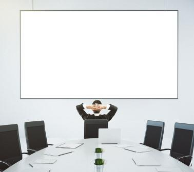 stock-photo-businessman-looks-at-blank-poster-on-the-wall-in-modern-conference-room-mock-up-376609825